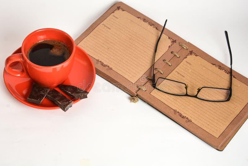 Café y cuaderno imagen de archivo libre de regalías