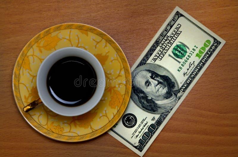 Café y dólares imágenes de archivo libres de regalías