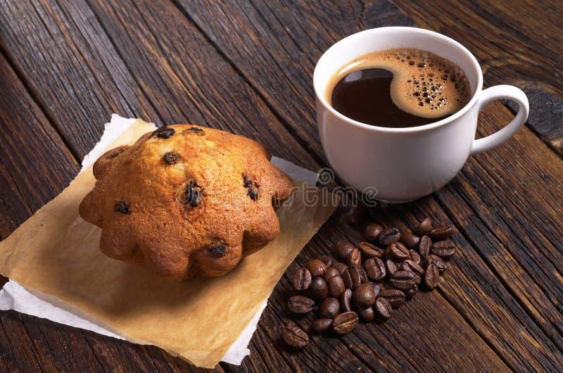 Café y magdalena foto de archivo