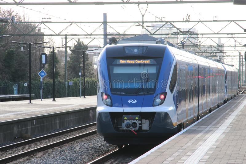 CAF Civity local commuter springer SNG3 train at the trainstation of Den Haag Laan van NOI in the Netherlands. stock photos