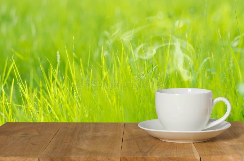 Caf? do caf? na tabela de madeira fotografia de stock
