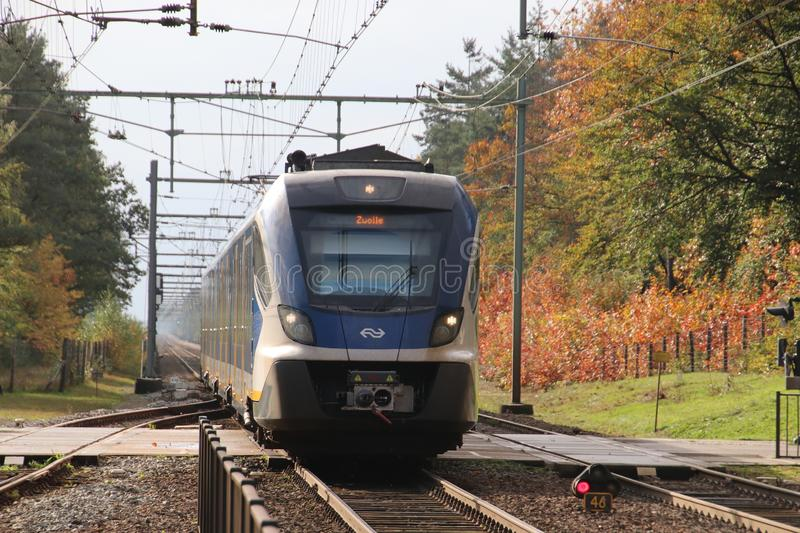 CAF SNG civility local commuter train arriving at station of `t Harde during Autumn heading to Zwolle stock photo