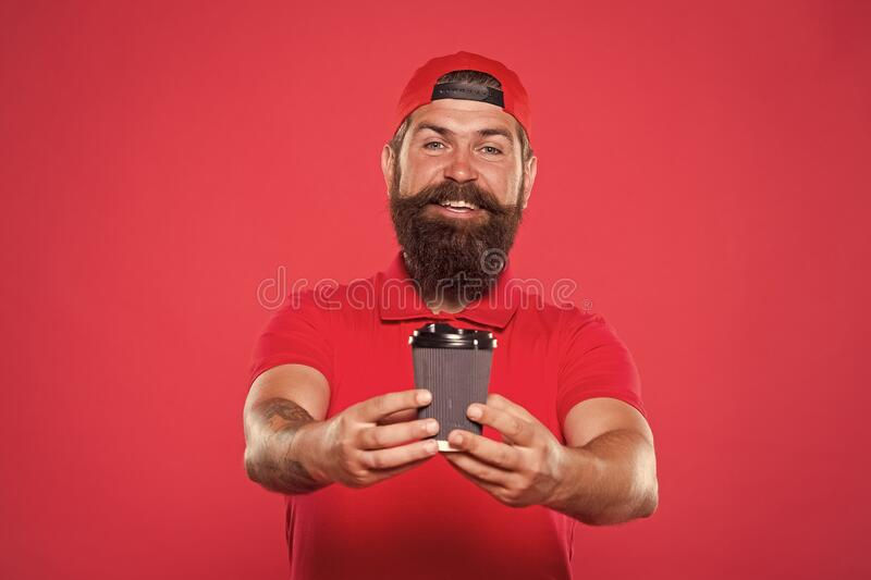 Cafe barista hold coffee cup. Delicious coffee. Contains caffeine. Coffee to go. Cafe stuff red uniform with cap serving. Drink. Enjoy high quality coffee stock photography