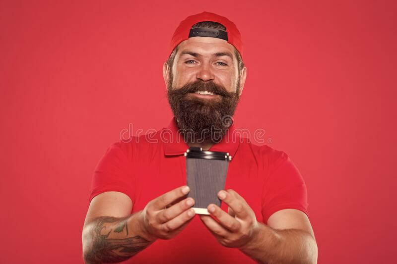 Cafe barista hold coffee cup. Coffee to go. Cafe stuff red uniform with cap serving drink. Enjoy high quality coffee. Cappuccino espresso menu. Paper cup royalty free stock image