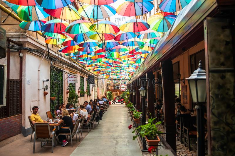 Cafe with colorful umbrellas on a street stock images