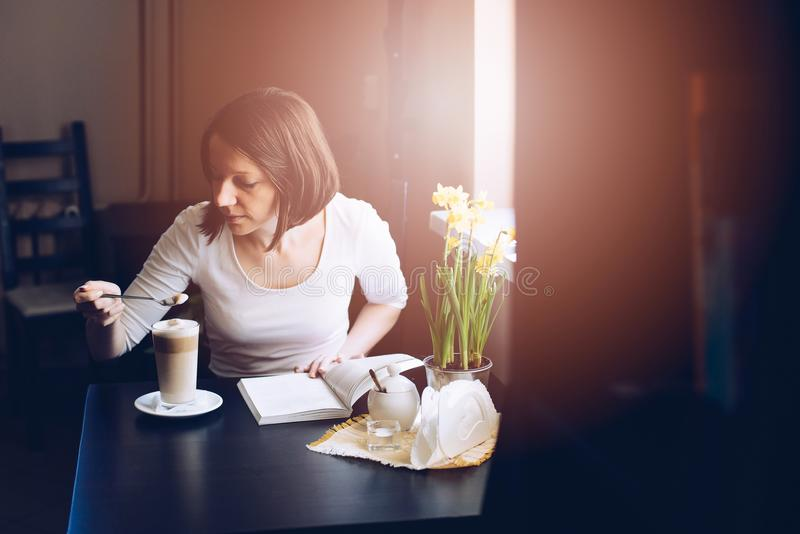 Cafe customer tasting caffe latte stock image