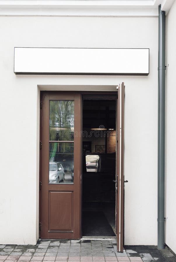 Cafe doors with empty signage mockup stock photos