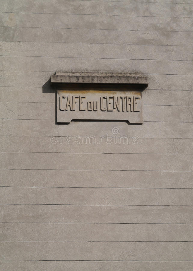 Cafe du Centre concrete sign on a wall in France. Centre sign as architecture stock photo