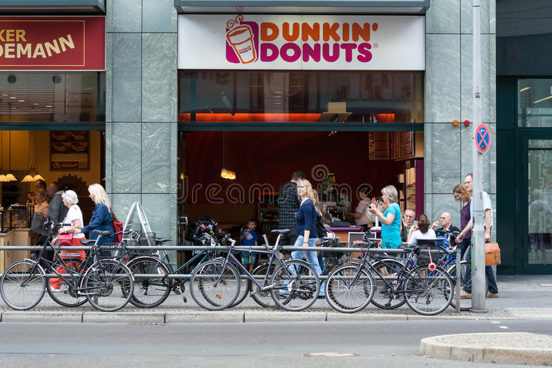 cafe dunkin donuts on friedrichstrasse editorial stock. Black Bedroom Furniture Sets. Home Design Ideas