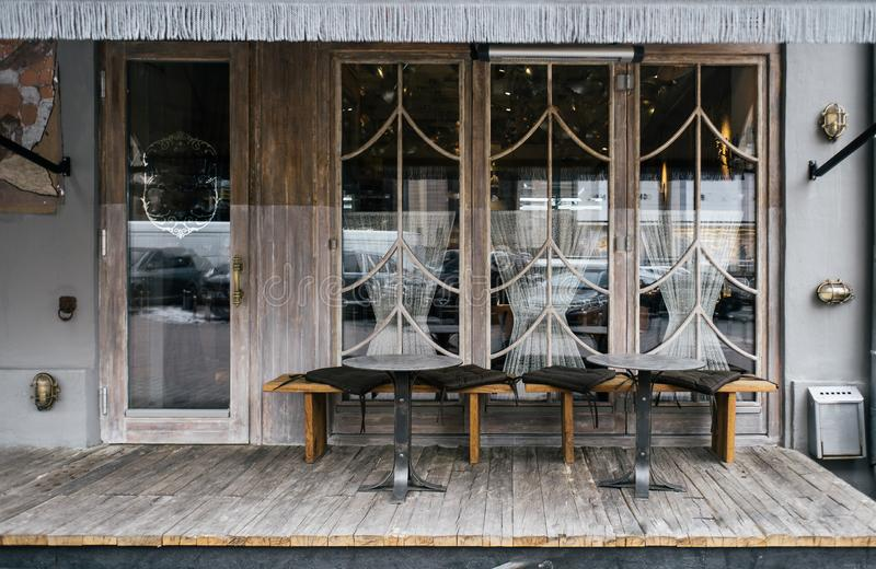 A cafe facade design with stylish elements and furniture royalty free stock photo
