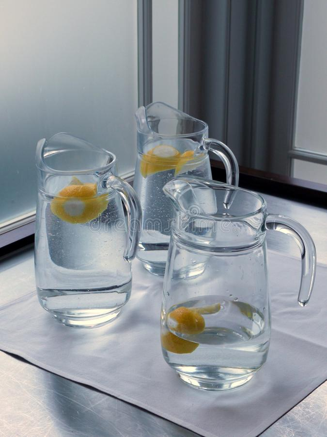 Download Cafe: Glass Water Jugs With Lemon Stock Image - Image of lemon, steel: 22443353