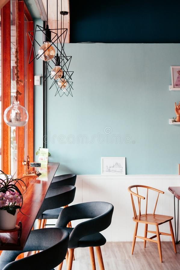 Cafe interior decoration with stool and chair contemporary modern design room with pastel wall colour. Cafe interior decoration with stool and chair contemporary stock images