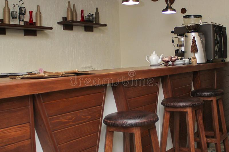 Cafe interior design with bar and wooden chairs stock photography