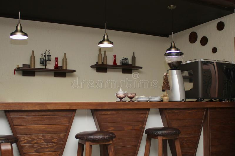 Cafe interior design with bar and wooden chairs royalty free stock photos