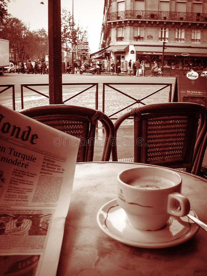 Cafe cafe journal reading newspaper and having coffee on terrace paris sepia stock photography