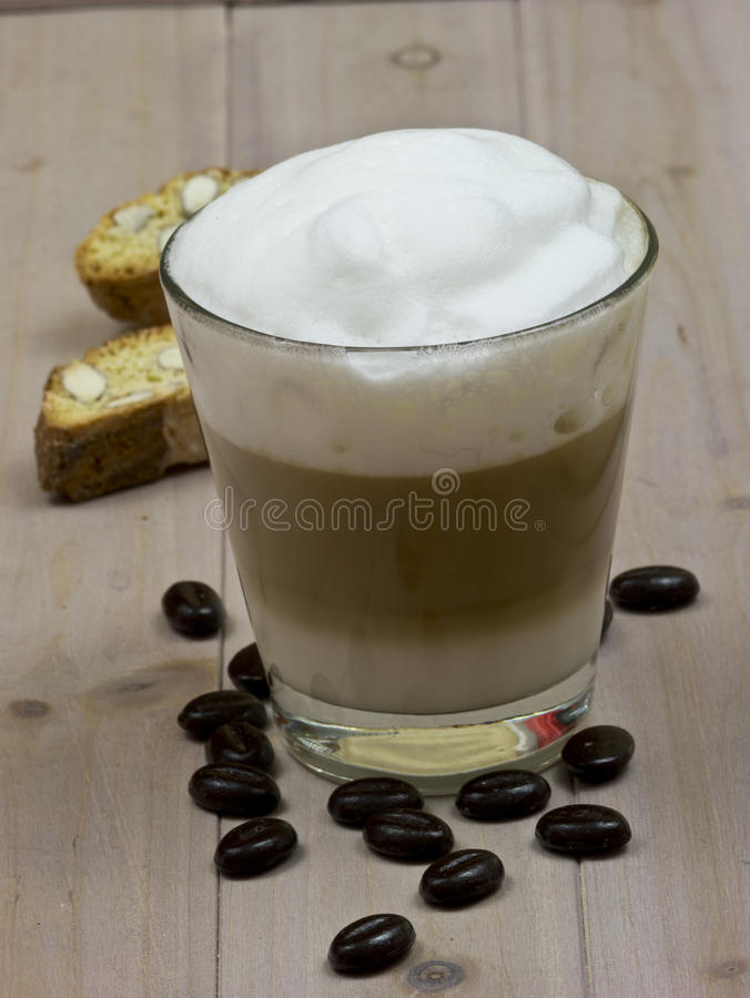 Cafe Latte. Slat Macchiato with coffee beans and Cantuccini royalty free stock images