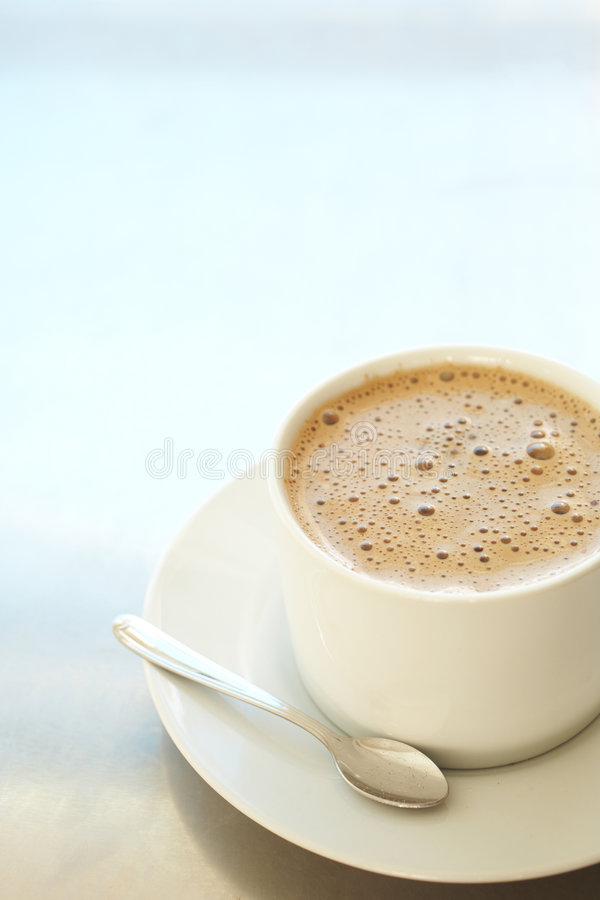 Cafe latte in coffee cup stock photography
