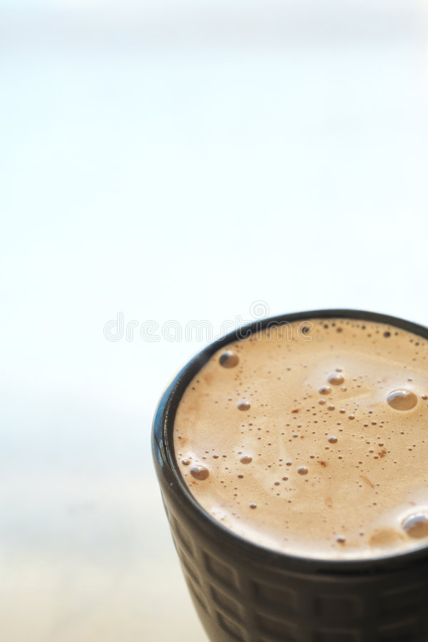 Cafe latte in coffee mug stock images
