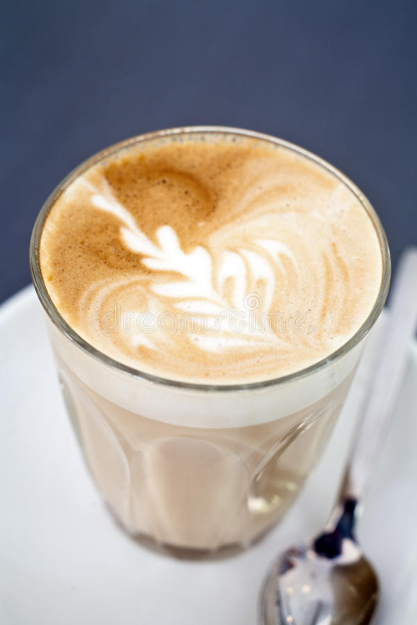 Cafe Latte in a glass royalty free stock photos