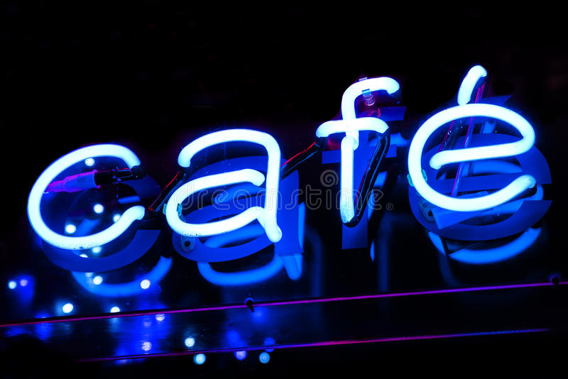 Cafe Neon Sign. A close-up of a neon Cafe sign stock photography