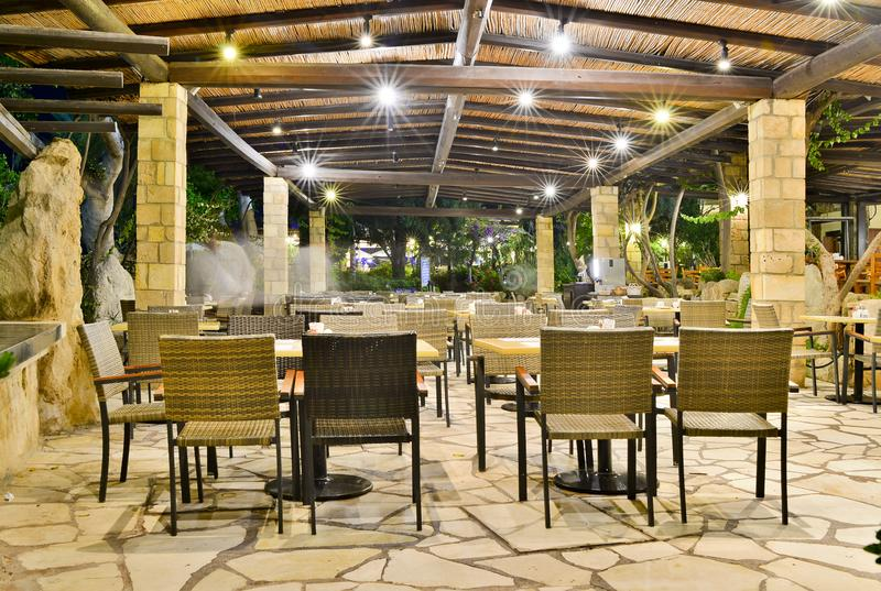 Cafe at night at the Coral Beach Hotel Resort Cyprus Paphos in June 2017 in Cyprus royalty free stock images