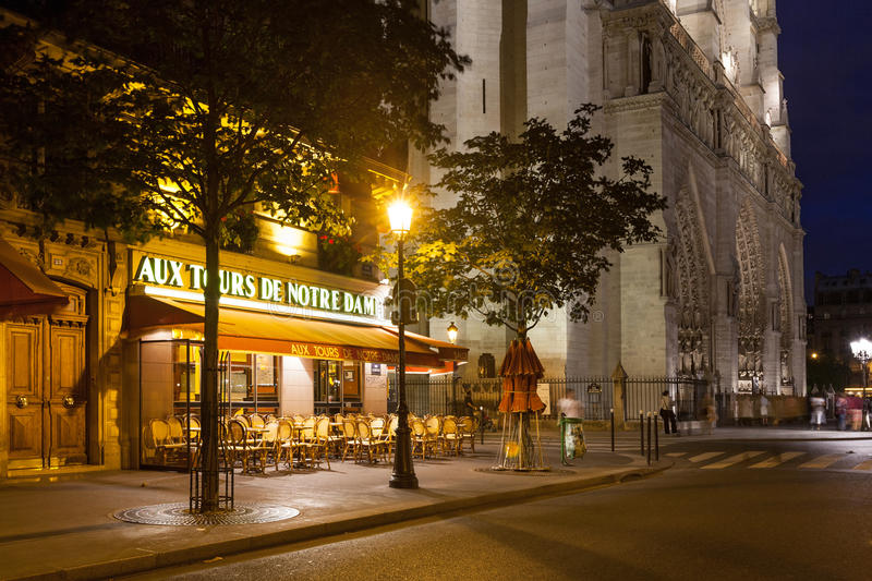 A cafe beside the Notre Dame in Paris stock photos