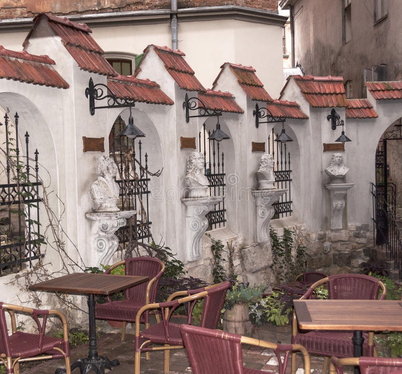 Download Cafe Between Old Buildings Royalty Free Stock Photography - Image: 26581037