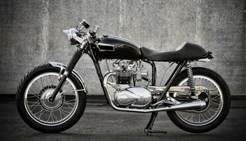 Cafe Racer motorcycle. Nice customized vintage cafe racer, most all wires are hidden, oil tank hidden in the gas tank royalty free stock image