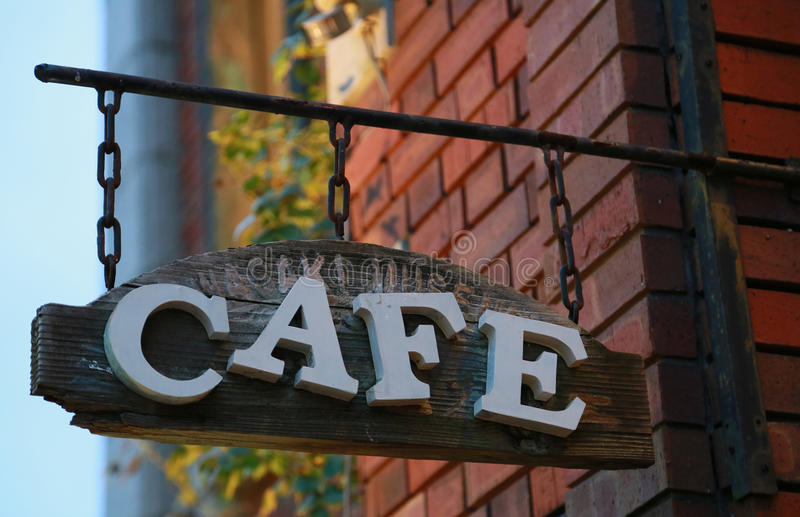 Cafe shop sign of the brick building. The signboard which was hung of the cafe of the brick building stock photography