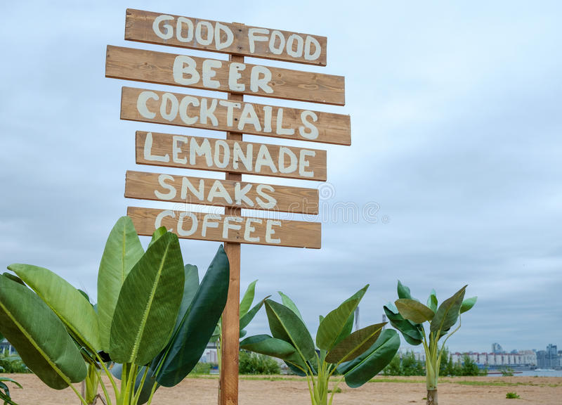 Cafe signpost on the beach. Cafe signpost summer and holiday landscape royalty free stock images