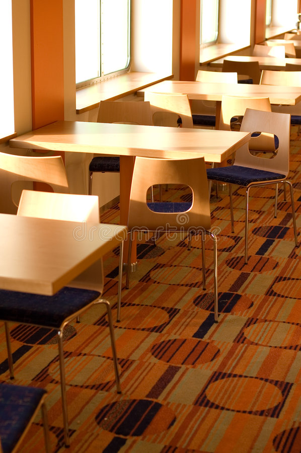 Cafe table and chairs. Chairs and tables at a fast food cafe on a cruise ship royalty free stock images
