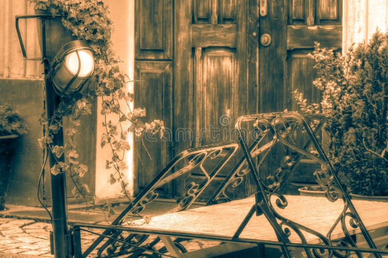 Cafe table in idyllic scenery, HDR photo in Sepia royalty free stock photo