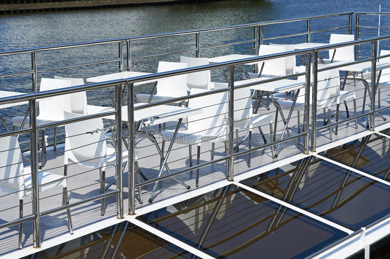 Cafe tables on deck of pleasure boat royalty free stock image