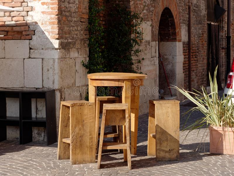 Cafe tables on the street in Mantova, Italy. 2019 stock photography