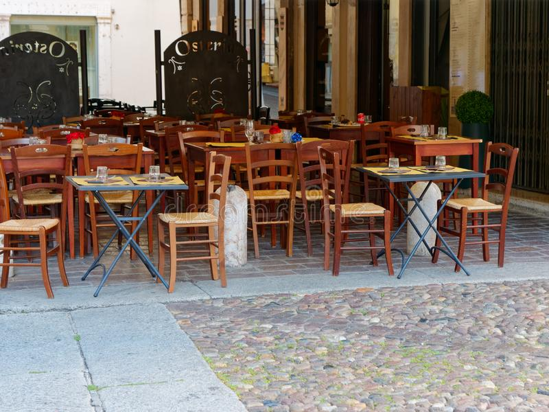 Cafe tables on the street in Mantova, Italy. 2019 stock photos