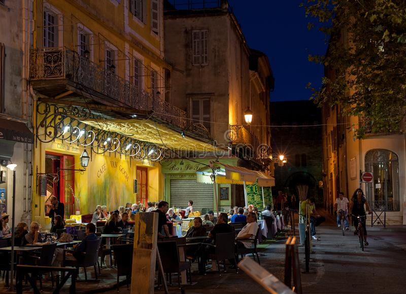 Cafe Van Gogh, Arles, France. Arles, Provence-Alpes-Cote d`Azur, France - September 15, 2010: Warm summer evening in the famous cafe full of visitors at the royalty free stock photography