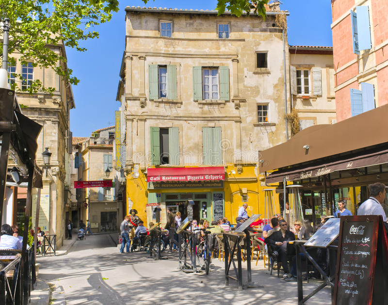 Cafes, Arles France. Cafes line the Place du Forum in Arles, Provence, in the south of France, surrounded by the charming shuttered buildings of the city. It is