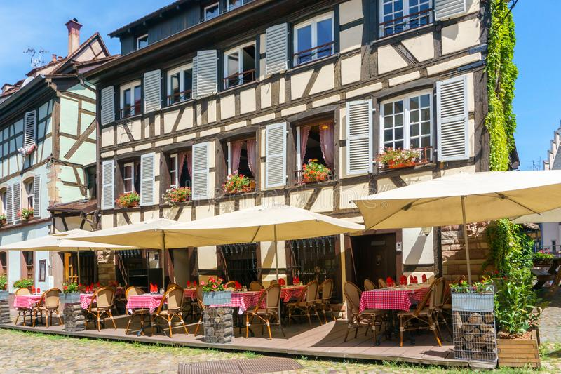 Cafes and restaurant in Petite-France in Strasbourg. Traditional colorful houses in La Petite France, Strasbourg, Alsace, France royalty free stock image