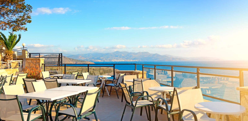 cafes seascape Grekland royaltyfria bilder