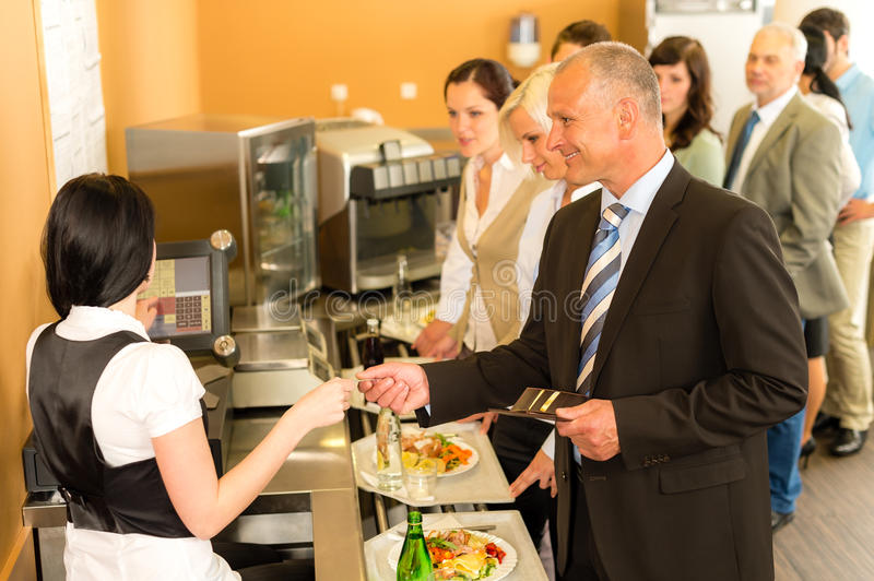 Cafeteria business man pay by credit card cashier. Cafeteria men pay by credit card cashier food on serving tray royalty free stock photo