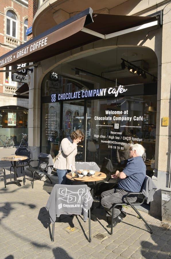 Cafeteria en Leuven. Leuven, Belgium - April 1, 2019: Having coffee outside cafeteria in   Leuven, Belgium stock image