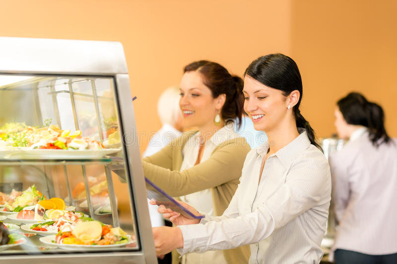 Cafeteria lunch young woman take salad plate royalty free stock photo