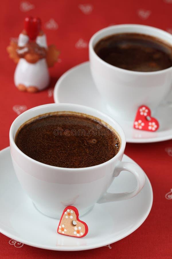 Caffè con i cuori e l'angelo fotografia stock libera da diritti
