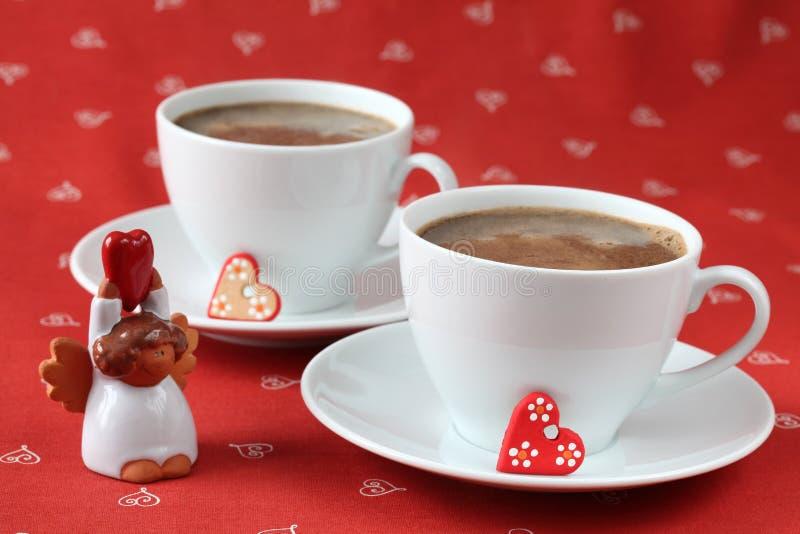 Caffè con i cuori e l'angelo immagine stock libera da diritti