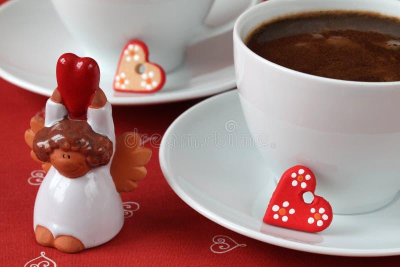 Caffè con i cuori e l'angelo fotografia stock