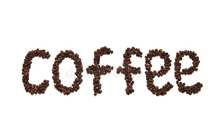 Caffè del granulo scritto parola del caffè fotografia stock libera da diritti