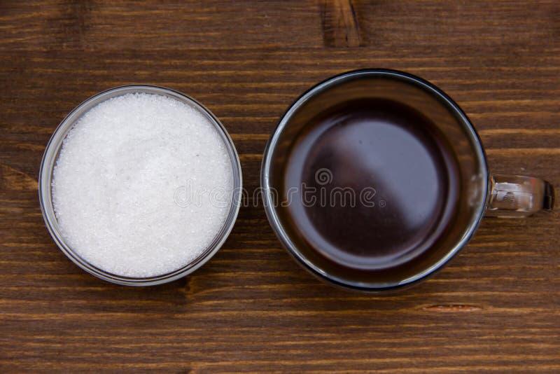 Caffè e zucchero sulla cima di legno immagini stock libere da diritti