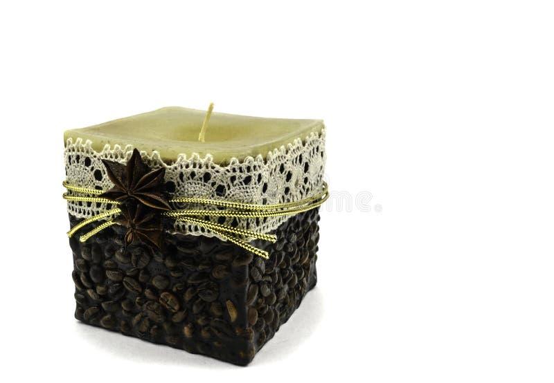 Caffè fatto a mano della candela su un fondo bianco fotografia stock libera da diritti