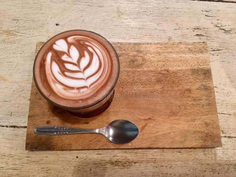 Hot drink. Top view. Delicious latte. Morning caffe mocha. top view. Hot Drink. A caffè mocha, on a wooden table with spoon, also called mocaccino, is a stock image