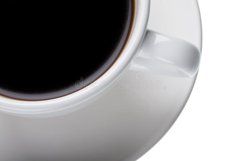 Caffè nero in tazza bianca sul piattino fotografia stock libera da diritti